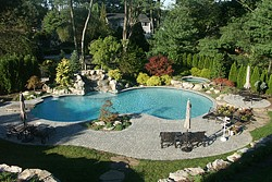 Gunite Pool Designs gunite pool design ideas home decor gallery Tiled Swimming Lanes Custom Steps Freeform Design Attached Spas And Waterfalls Are Just Some Of The Many Features In An Aqualand Gunite Pool